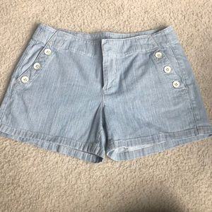 Super cute size 4 Loft denim shorts. Accent button